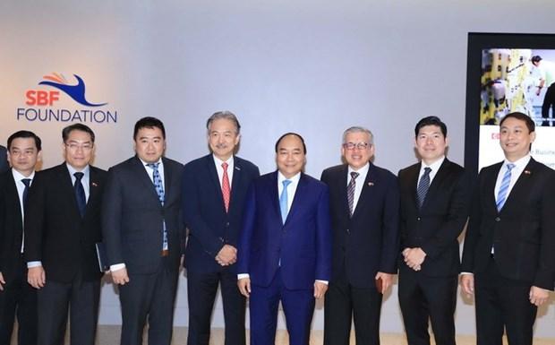 Premier vietnamita se reune con gerentes de grupos singapurenses hinh anh 1