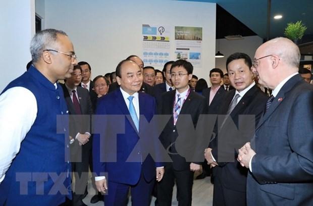 Premier vietnamita aboga por agilizar cooperacion con Singapur para apoyar a emprendedores hinh anh 1