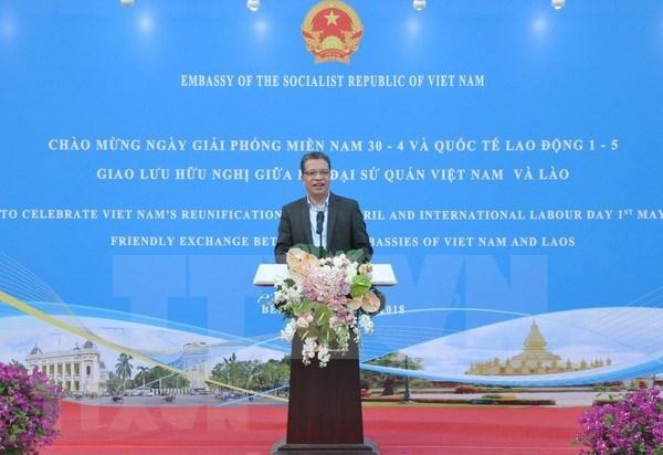 Efectuan intercambio de amistad Vietnam-Laos en Beijing hinh anh 1