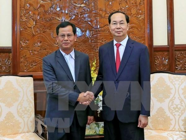 Presidente de Vietnam aboga por impulsar cooperacion con Laos en seguridad hinh anh 1