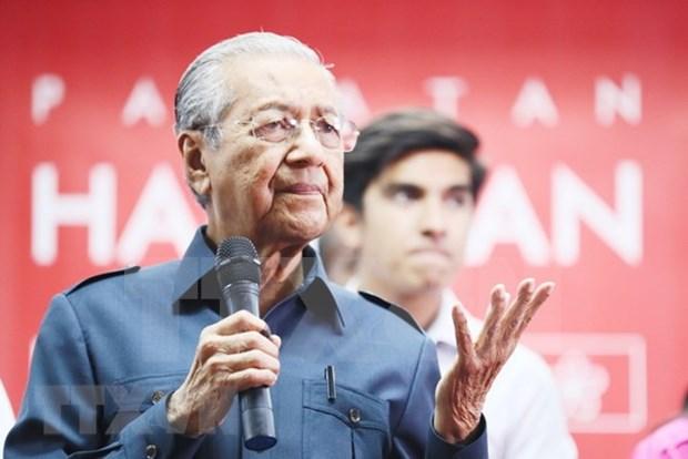 Malasia elimina impuestos sobre bienes y servicios a partir de junio hinh anh 1
