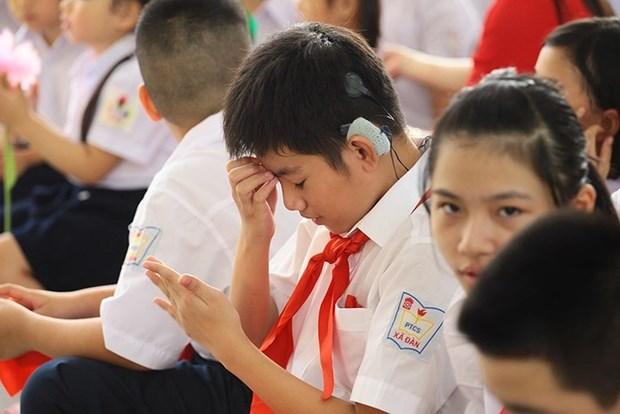 Asistencias estadounidenses a personas sordas en Vietnam hinh anh 1