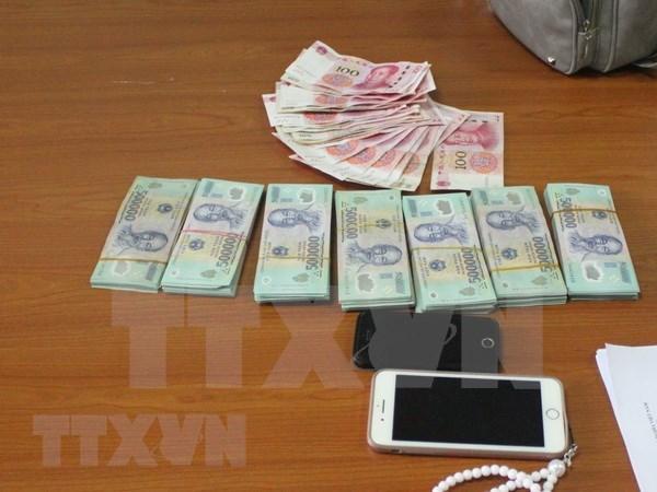Quang Ninh: Inician procedimiento legal por trafico ilegal de dinero a traves de frontera hinh anh 1