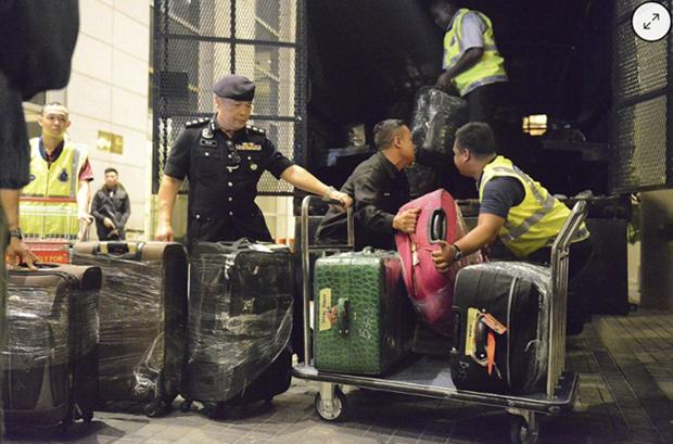 Policia de Malasia decomisa millones de dolares en la investigacion del fondo 1MDB hinh anh 1