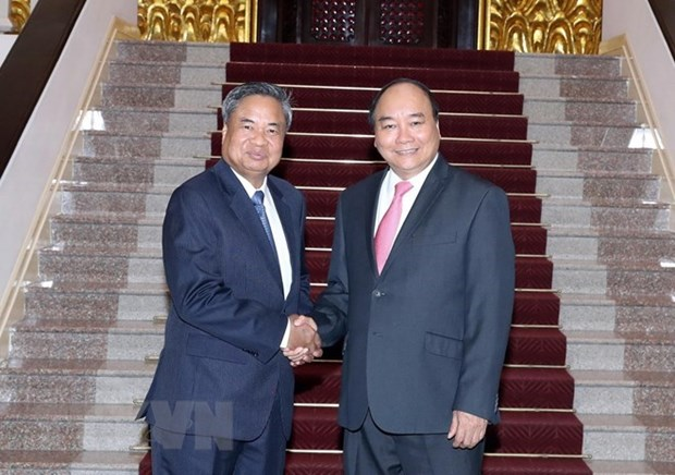 Premier vietnamita promete mas apoyo en la capacitacion del personal a Laos hinh anh 1