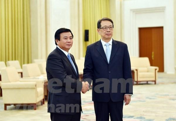 Robustecen nexos entre Partidos Comunistas de Vietnam y China hinh anh 1