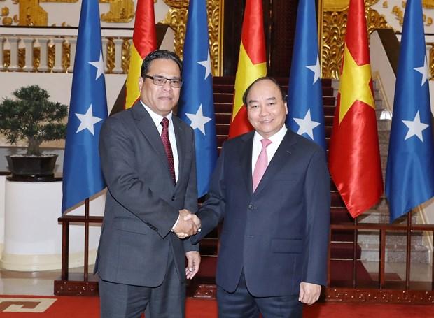 Premier de Vietnam exhorta a impulsar nexos comerciales e inversionistas con Micronesia hinh anh 1