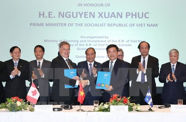 Premier de Vietnam testimonia firma de memorandos de cooperacion con Canada hinh anh 1