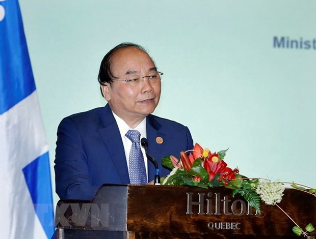 Premier vietnamita asiste al Coloquio Empresarial Vietnam-Canada hinh anh 1