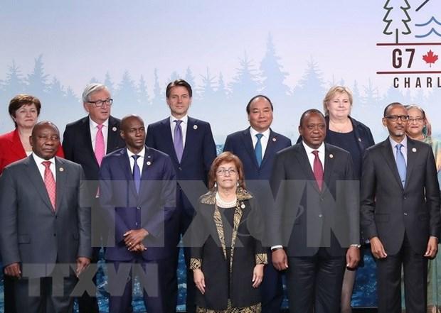 Premier vietnamita interviene en Cumbre ampliada del G7 hinh anh 1