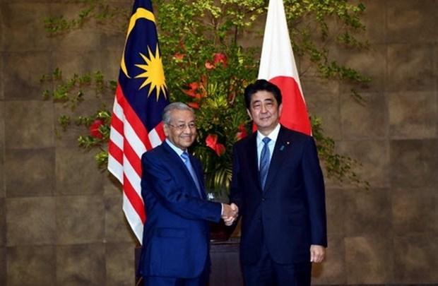 Japon y Malasia se comprometen a cooperar en asuntos relacionados con Corea del Norte hinh anh 1