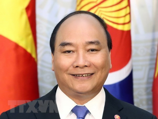 Primer ministro de Vietnam llega a Tailandia para reuniones regionales hinh anh 1