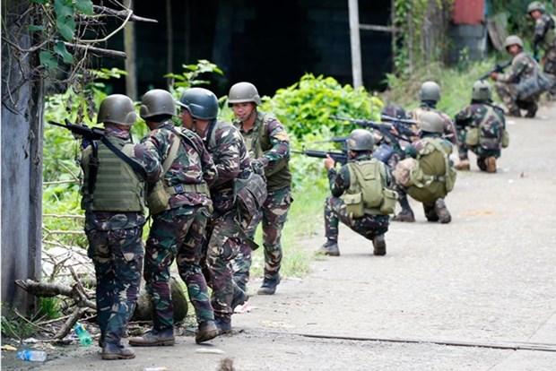 Ejercito de Filipinas se enfrenta con rebeldes terroristas en Marawi hinh anh 1