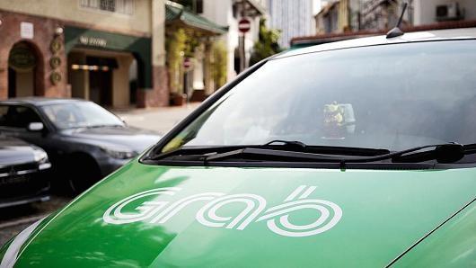 Toyota invierte mil millones de dolares en Grab, lider de transporte compartido en Asia hinh anh 1
