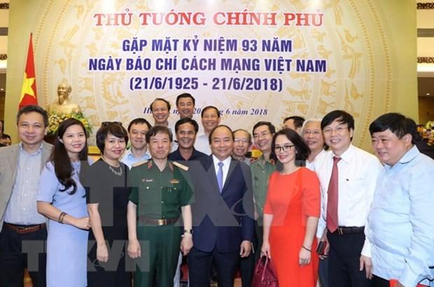 Premier vietnamita pide a la prensa nacional contribuir a consolidar consenso social hinh anh 1