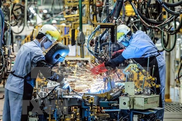Especialistas adelantan perspectivas positivas para el crecimiento economico de Vietnam hinh anh 1