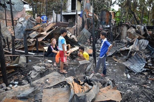 Comunidad vietnamita en Camboya ayuda a victimas de incendio hinh anh 1