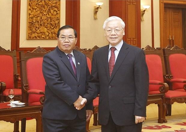 Maximo dirigente partidista de Vietnam recibe al vicepresidente del Parlamento de Laos hinh anh 1