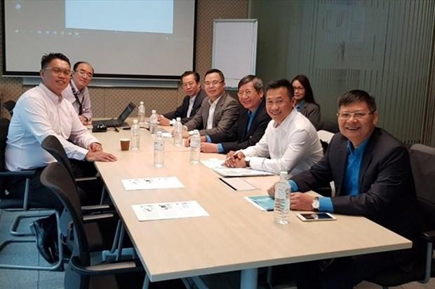 Delegacion de Confederacion de trabajadores de Vietnam visita Singapur hinh anh 1