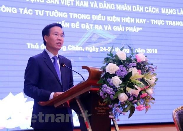 Vietnam y Laos concluyen intercambio teorico sobre el trabajo ideologico hinh anh 1