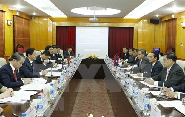 Inspectores generales de Vietnam y Laos comparten experiencias hinh anh 1