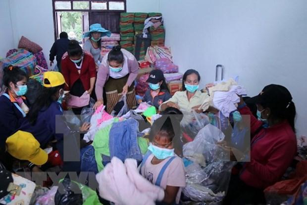 Gobierno, organizaciones y entidades vietnamitas apoyan con donaciones a victimas del colapso de presa en Laos hinh anh 1