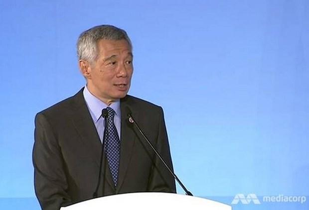 Premier de Singapur insta a compromisos regionales a favor de libre comercio hinh anh 1