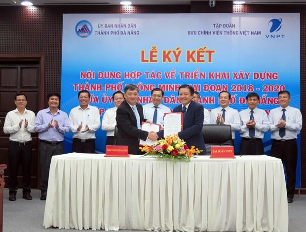 Da Nang coopera con grupo de telecomunicaciones VNPT en construccion de ciudad inteligente hinh anh 1