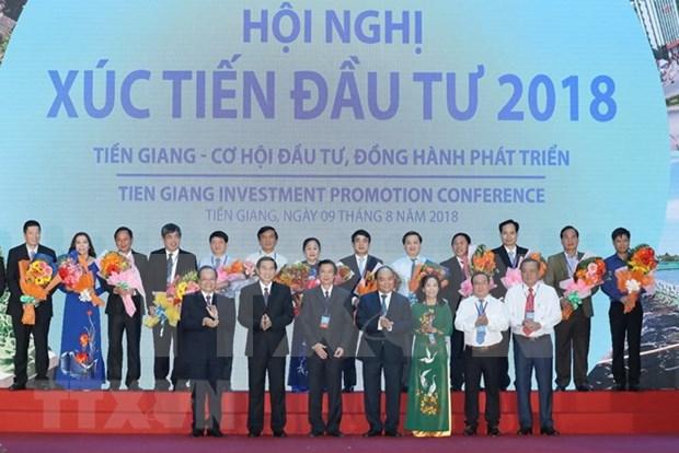 Premier vietnamita asiste a conferencia de promocion inversionista en Tien Giang hinh anh 1