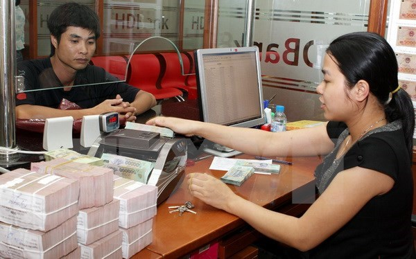 Tasa de uso de efectivo en Vietnam se reducira a ocho por ciento en 2025 hinh anh 1
