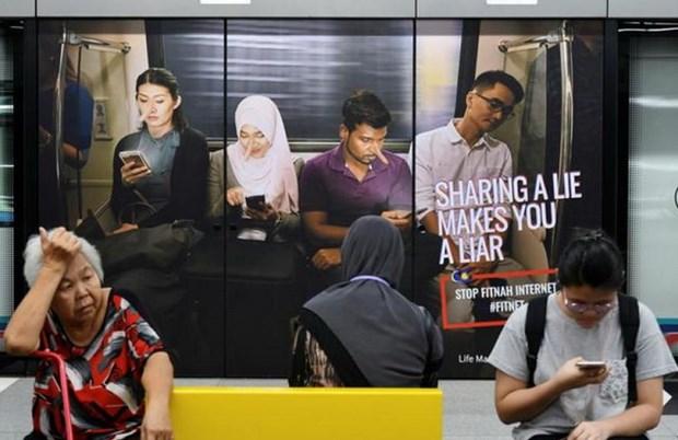 Malasia deroga ley contra noticias falsas hinh anh 1