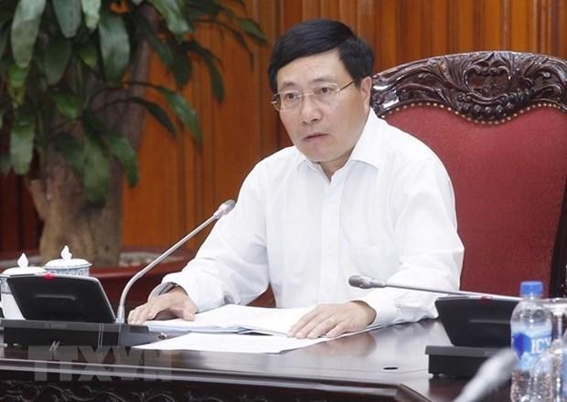Vicepremier vietnamita urge a aclerar preparativos para Foro Economico Mundial sobre la ASEAN hinh anh 1