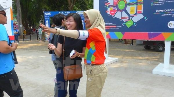 Voluntarios son indispensables para buen desarrollo de Juegos Asiaticos en Indonesia hinh anh 1