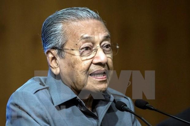 Premier de Malasia confia que su pais se beneficiara de guerra comercial China- Estados Unidos hinh anh 1