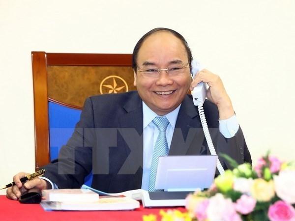 Premier de Vietnam felicita al equipo de futbol por su gran triunfo en ASIAD 2018 hinh anh 1