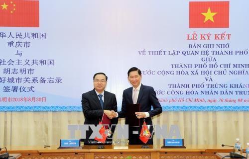 Ciudad Ho Chi Minh y municipio chino de Chongqing establecen relaciones de amistad hinh anh 1
