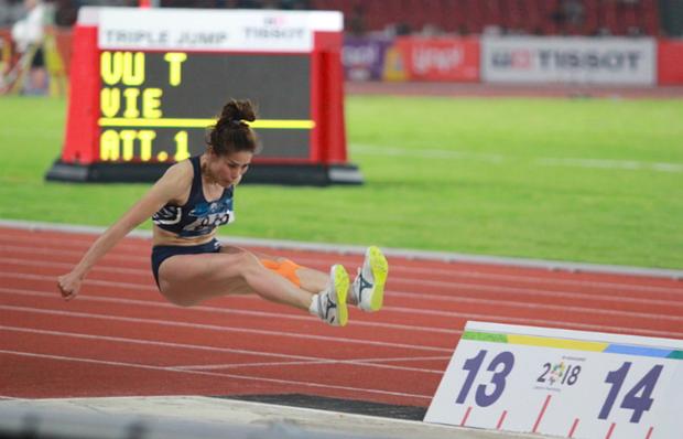Atleta vietnamita gana bronce en triple salto en Juegos Asiaticos hinh anh 1
