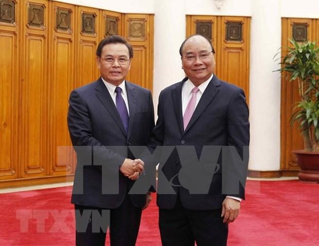 Premier de Vietnam llama a intensificar divulgacion sobre relaciones amistosas con Laos hinh anh 1