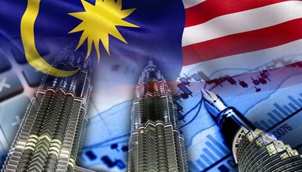 Standard Chartered reduce pronostico del crecimiento economico de Malasia hinh anh 1