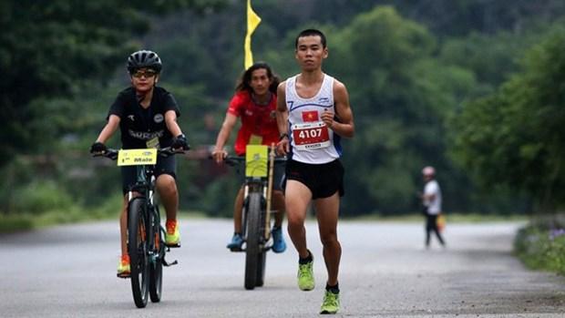 Atletas y aficionados de 17 paises participaron en maraton Trang An 2018 hinh anh 1