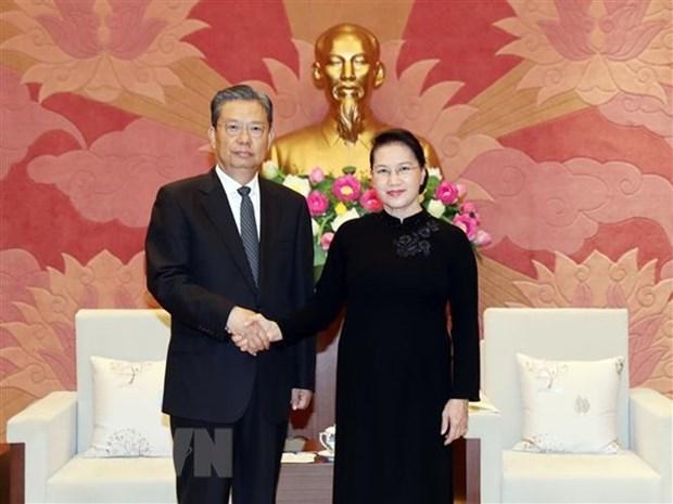 Presidenta del Parlamento de Vietnam recibe a dirigente partidista de China hinh anh 1