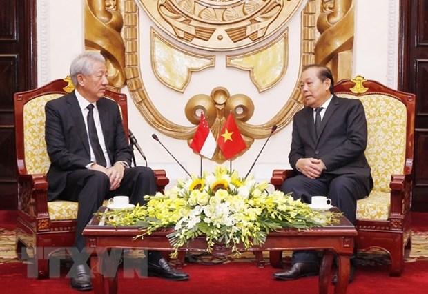 Vicepremier vietnamita recibe a su homologo singapurense hinh anh 1