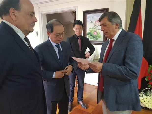 Rinden homenaje a presidente de Vietnam Tran Dai Quang en Chile hinh anh 1