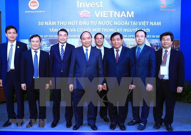 Premier vietnamita ratifica importancia vital de inversion extranjera para el desarrollo nacional hinh anh 1
