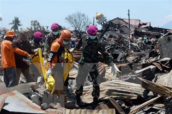 Mas de mil personas permanecerian desaparecidas tras desastres en Indonesia hinh anh 1