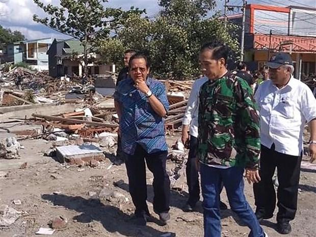 Presidente indonesio insta a acelerar labores de rescate tras sismo hinh anh 1