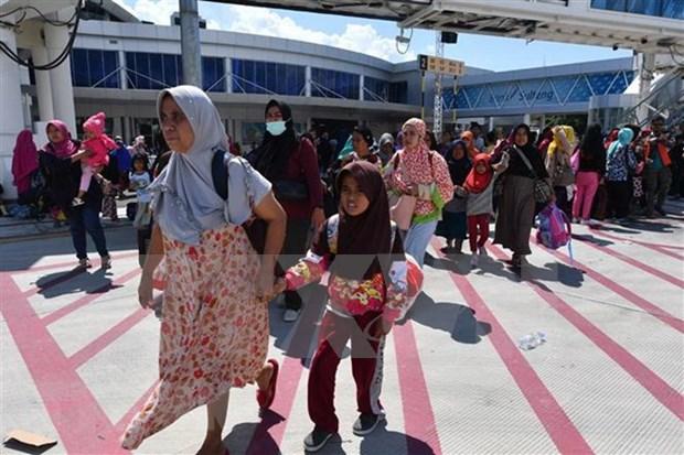 Aeropuerto indonesio reanudara pronto su pleno funcionamiento tras desastres naturales hinh anh 1