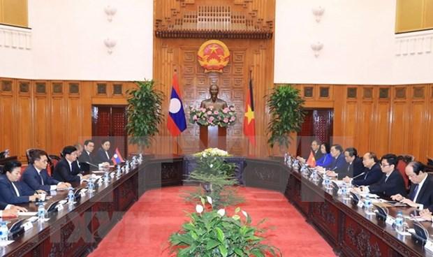 Premier laosiano resalta aportes del exsecretario generel del PCV, Do Muoi, a nexos bilaterales hinh anh 1