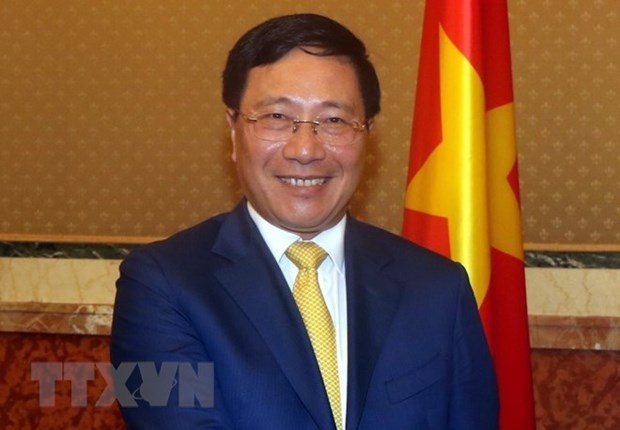 Vicepremier y canciller de Vietnam asiste al Foro empresarial con Reino Unido hinh anh 1