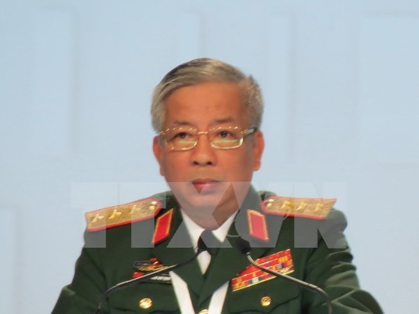 Efectuan simposio cientifico sobre Libro Blanco de Defensa de Vietnam hinh anh 1